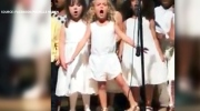 Girl steals show at pre-kindergarten graduation