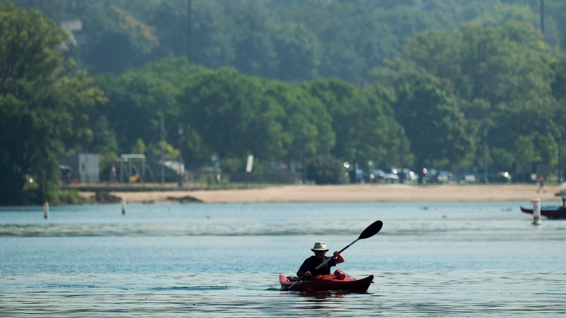 A man kayaks in Lake Ontario on a warm sunny day in Toronto on Friday, August 19, 2016. THE CANADIAN PRESS/Nathan Denette