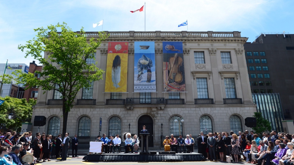 Prime Minister Justin Trudeau speaks in front of the former U.S. embassy during National Indigenous Peoples Day celebrations in Ottawa on Wednesday, June 21, 2017. The building will be converted into a centre dedicated to indigenous people. (THE CANADIAN PRESS/Sean Kilpatrick)