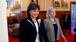 Premier Christy Clark arrives with Lieutenant-Governor Judith Guichon for a swearing-in ceremony for the provincial cabinet at Government House in Victoria, B.C., on Monday, June 12, 2017. THE CANADIAN PRESS/Chad Hipolito