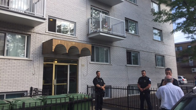 Montreal police outside the home of a man suspected of stabbing a police officer in the Flint, MI airport on Wednesday. (Photo: Caroline Van Vlaardingen/CTV Montreal)