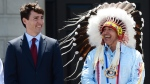 Prime Minister Justin Trudeau and Perry Bellegarde, national chief of the Assembly of First Nations, celebrate National Indigenous Peoples Day in Ottawa. (THE CANADIAN PRESS / Sean Kilpatrick)