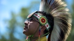 Grass dancer Stanford Tom from Lake of the Woods Region is shown on National Aboriginal Day at Major's Hill Park in Ottawa. (THE CANADIAN PRESS / Justin Tang)