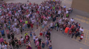 Kitchener school creates giant maple leaf out of students.