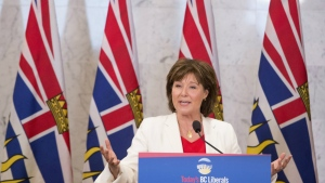 British Columbia Premier Christy Clark addresses a gathering in Vancouver, B.C. on Wednesday, June 21, 2017. ( Jonathan Hayward / THE CANADIAN PRESS)