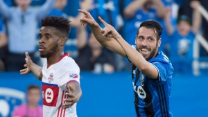 Montreal Impact forward Matteo Mancosu, right, celebrates his goal next to Toronto FC forward Raheem Edwards during first half of the first leg of the Canadian Championship soccer final action, in Montreal on Wednesday, June 21, 2017. THE CANADIAN PRESS/Paul Chiasson