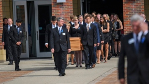 The casket of Otto Warmbier is carried from Wyoming High School after his funeral, on June 22, 2017. (Bryan Woolston / AP)