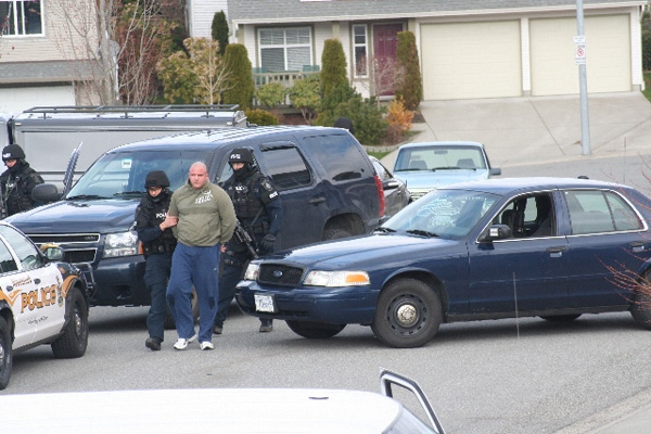 Heavily armed police arrest Jamie Bacon, who police say is a notorious gang member, outside his Abbotsford, B.C., home early morning on Friday, April 3, 2009 (special to ctvbc.ca)