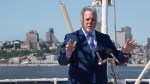 Quebec Premier Philippe Couillard speaks at a news conference aboard a tourist cruise ship on the St. Lawrence River in Quebec City, on June 22, 2017. (Jacques Boissinot / THE CANADIAN PRESS)