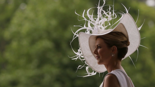 Barbra Studwick wears a white and feather ornate hat on the third day of the Royal Ascot horse race meeting, which is traditionally known as Ladies Day, in Ascot, England Thursday, June 22, 2017. (AP Photo/Alastair Grant)