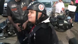 Xander Rose, 10, received his very own leather vest as a gift from Bay Boys Motorcycle Club.