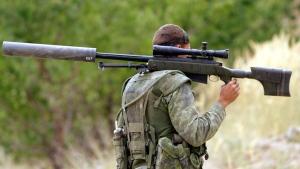 In this file photo, a Canadian sniper walks up a hill to his position near Kabul Afghanistan Wednesday Aug 27, 2003. (Stephen Thorne / THE CANADIAN PRESS)