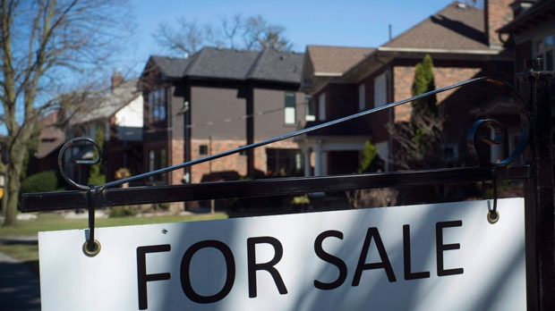 A sold sign is shown in front of west-end Toronto homes on April 9, 2017. (THE CANADIAN PRESS/Graeme Roy)