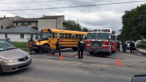 Emergency crews respond after a school bus hit a 78-year-old woman in Saskatoon. (Colin Thomas/CTV Saskatoon)