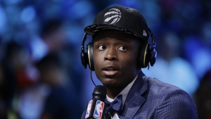 Indiana's OG Anunoby answers questions during an interview after being selected by the Toronto Raptors as the 23rd pick overall during the NBA basketball draft in New York on Thursday, June 22, 2017. (AP / Frank Franklin II)