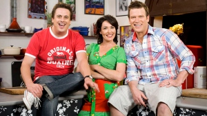 In this undated photo released by Foxtel, Darren Simpson, left, poses with his co-hosts and fellow chefs Anna Gare and Ben O'Donoghue during a promotion for their cooking show 'The Best in Australia.' (Foxtel via AP)