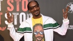 In this Wednesday, June 21, 2017, file photo, Snoop Dogg arrives at the Los Angeles premiere of 'Can't Stop, Won't Stop: A Bad Boy Story' at the Writers Guild Theater on in Beverly Hills, Calif. (Photo by Chris Pizzello/Invision/AP, File)