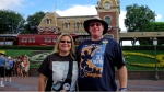 FILE -- In this Sunday, July 1, 2012, photo, Jeff Reitz and Tonya Mickesh pose for a picture at the halfway point, day 183, in their mission to visit Disneyland in Anaheim, Calif., every day of the year. (AP Photo/The Orange County Register, Mark Eades)