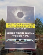 A poster advertising the Aug. 21 total solar eclipse hangs in the window of a McDonald's restaurant in Madras, Oregon on June 12, 2017.(AP Photo/Gillian Flaccus)