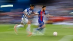 Barcelona's Lionel Messi, right, is challenged by Alaves' Theo Hernandez at the Vicente Calderon stadium in Madrid, Spain, on May 27, 2017. (Daniel Ochoa de Olza / AP)