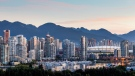 Vancouver's skyline at sunrise is shown in a handout photo. (Destination BC/Albert Normandin via The Canadian Press)
