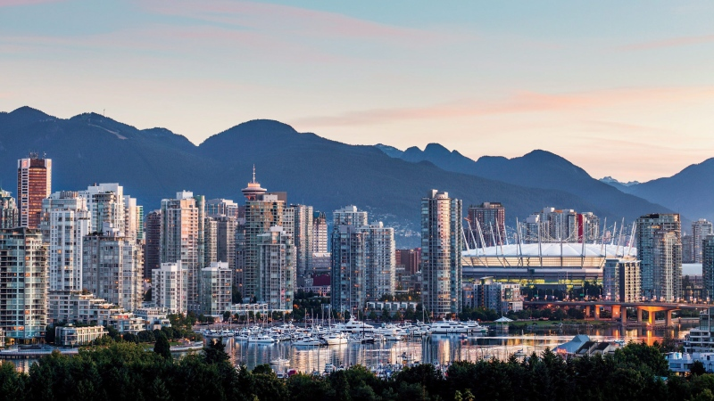 Vancouver's skyline at sunrise is shown in this undated handout photo. Vancouver has been placed on travel site Lonely Planet's top ten list of cities to visit in 2020. (Destination BC/Albert Normandin via The Canadian Press)