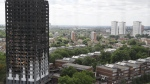 The burnt Grenfell Tower apartment building stands testament to the recent fire in London, Friday, June 23, 2017. (AP Photo/Frank Augstein)