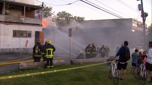 Firefighters  battle a blaze that destroyed six businesses and a home in Vancouver's Kerrisdale neighbourhood. June 22, 2017. (CTV)