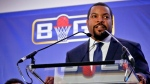 Former NBA player and players union deputy Roger Mason, left, listens as entertainer Ice Cube, right, announces the launch of the BIG3, a new 3-on-3 professional basketball league, in New York on Jan. 11, 2017. (AP /Bebeto Matthews, )