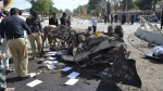 Pakistani police officers examine the site of an explosion in Quetta, Pakistan, Friday, June 23, 2017. (AP Photo/Arshad Butt)