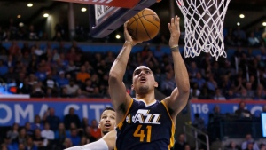 Forward Trey Lyles, then with the Utah Jazz, shoots in front of Oklahoma City Thunder forward Andre Roberson, rear, in the fourth quarter of an NBA basketball game in Oklahoma City, Saturday, March 11, 2017. Oklahoma City won 112-104. (AP Photo/Sue Ogrocki)