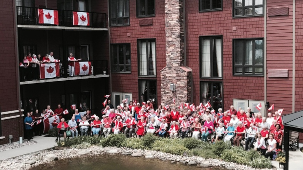 From Tracy Jones via MyNews: Residents of Riverdale Terrace Waterfront Retirement Residence Gather yesterday to Celebrate 150 Years for Canada.  We had local businesses, families and residents all in the picture to hold 150 Canada Flags. To my surprise the residents started to sing O Canada to show their support, combined their ages total 8600 Canadian years! We have 100 residents and 50 staff!