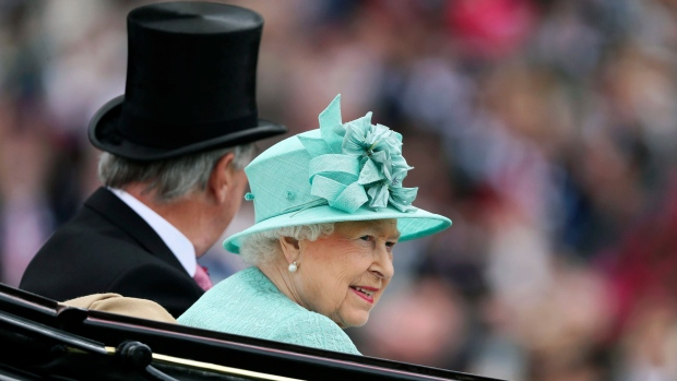Queen Elizabeth II arrives by carriage for day four of Royal Ascot at Ascot Racecourse, in Ascot, England, Friday June 23, 2017. (Brian Lawless/PA via AP)
