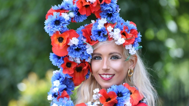 Natalia Beach from Surrey, poses for a photograph on day four of Royal Ascot at Ascot Racecourse, in Ascot, England, Friday June 23, 2017. (Jonathan Brady/PA via AP)