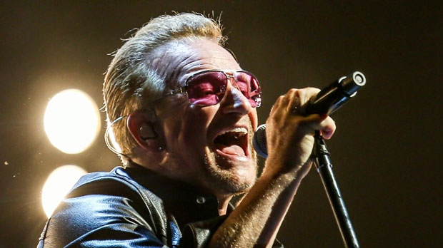 In this May 26, 2015, file photo, Bono of U2 performs at the Innocence + Experience Tour at The Forum in Inglewood, Calif. The special guests at U2's concert Thursday night, July 30, 2015 in New York, included Paul Simon, Lou Reed's widow and the woman who called 911 when Bono fell off his bike in New York City last year. (Photo by Rich Fury/Invision/AP, File)
