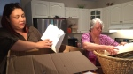 Christina Hajjar and her aunt go through boxes saved in the spring 2017 floods.