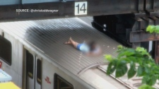 Girl hangs out on TTC train roof