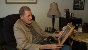 Jim Scharf holds a picture of him and his wife at his assisted living home in Kemptville, Ontario. June 23, 2017