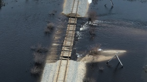 An undated image provided by OmniTRAX shows flood damage along the railway line to Churchill, Man.