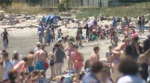 A crowd of sun-lovers packed Willows Beach in Oak Bay with temperatures set to soar even higher over the weekend. Friday, June 23, 2017. (CTV Vancouver Island)