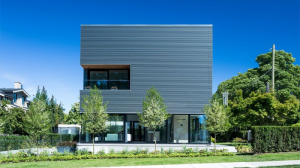 """Located on Point Grey Road, heralded as Vancouver's """"Golden Mile,"""" the concrete cube home was just listed for $14-million. The 3,709-square-foot modern home is eye-catching, modern and finished in concrete. The roof has two levels of private decking offering vistas of mountains and the Pacific Ocean, complete with a hot tub, retractable awning and outdoor shower. (Photos by Ema Peter)"""