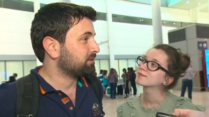 Khaled Almilaji, left, arrived in Toronto on Friday, June 16, 2017 with his wife, Jehan Mouhsen, right.
