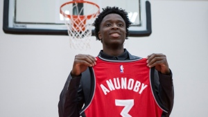 Toronto Raptors 2017 first round draft pick OG Anunoby holds a jersey as he poses for a picture after scrumming with journalists during a media availability in Toronto on Friday, June 23, 2017. THE CANADIAN PRESS/Chris Young