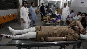 Injured victims of twin blasts in the northwestern town of Parachinar, are treated at a hospital in Peshawar, Pakistan, Saturday, June 24, 2017. (AP Photo/Muhammad Sajjad)