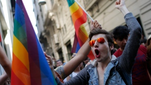 FILE - In this Sunday, June 28, 2015 file photo, participants of a Pride Week event in Istanbul, chant slogans after police used a water canon to disperse them. (AP Photo/Emrah Gurel, File)