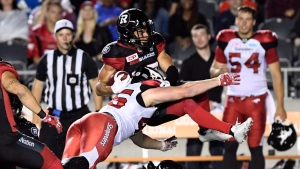 Ottawa Redblacks' Joshua Stangby (87) gets tackled by Calgary Stampeders' Charlie Power (46) during second half CFL action in Ottawa on Friday, June 23, 2017. (THE CANADIAN PRESS/Justin Tang)