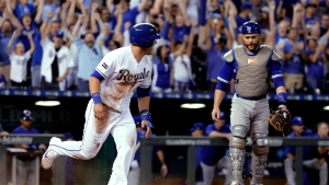 Kansas City Royals' Alex Gordon runs past Toronto Blue Jays catcher Russell Martin after scoring the winning run on a two-run double by hit by Whit Merrifield in the ninth inning of a baseball game Friday, June 23, 2017, in Kansas City, Mo. (AP Photo/Charlie Riedel)