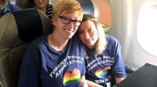 Officers are seen heading to New York City from Toronto to attend the Pride March on Saturday. (CP24)
