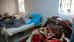 In this Monday, May 15, 2017 file photo, people are treated for suspected cholera infection at a hospital in Sanaa, Yemen. (AP Photo/Hani Mohammed, file)