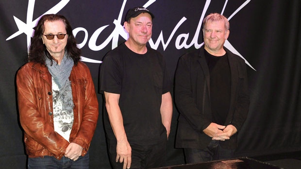 "Members of the band Rush, from left, Geddy Lee, Neil Peart, and Alex Lifeson of Rush attend the RockWalk induction of Rush at Guitar Center in Los Angeles, Nov.20, 2012. The offspring of Toronto's wandering capybaras now have names - Alex, Geddy and Neil, for members of the band Rush.The High Park Zoo says the ""capybabies"" were born in February to famed escape artists Bonnie and Clyde.THE CANADIAN PRESS/AP/Photo by Richard Shotwell/Invision/AP"